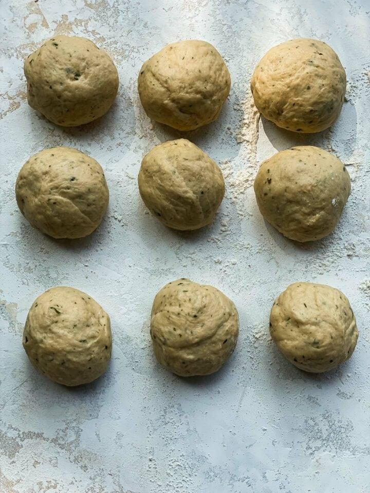 Bread dough rolls on a table