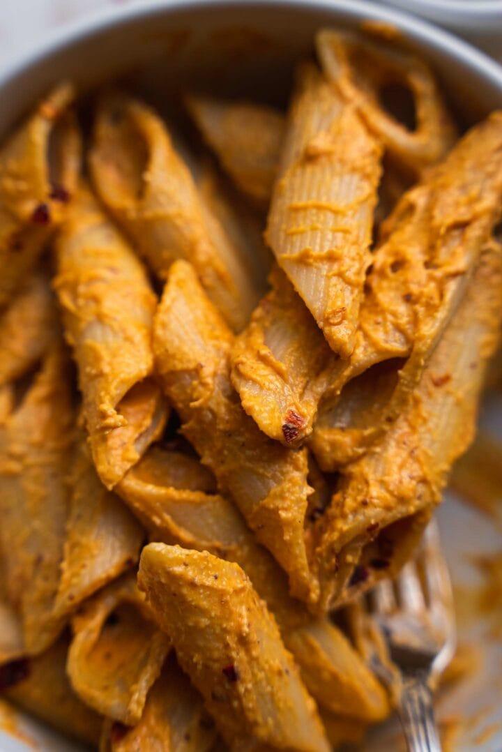 Closeup of vegan pasta with a pumpkin sauce