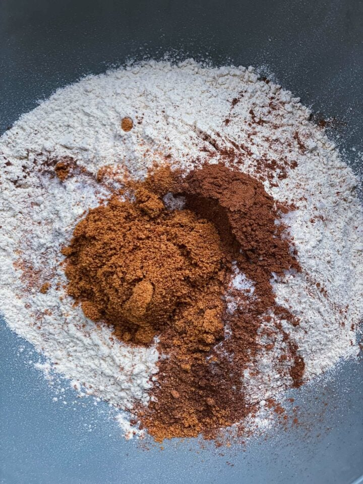 Dry ingredients for pumpkin bread in a mixing bowl