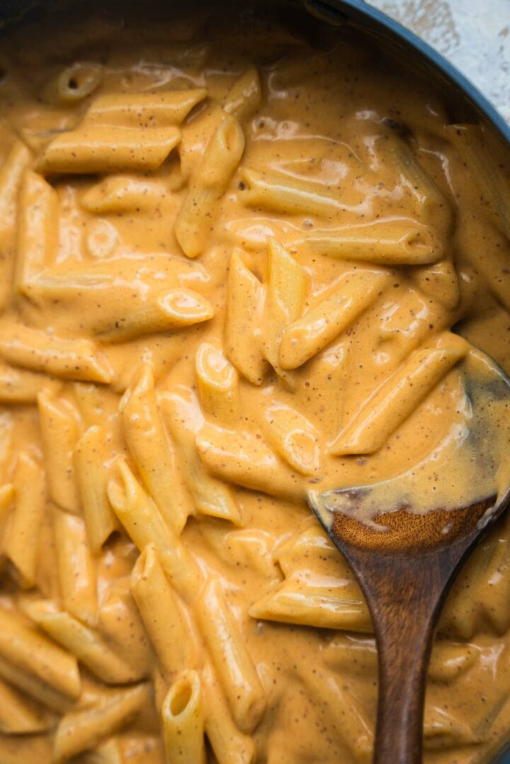 Pasta with a cheesy sauce in a frying pan
