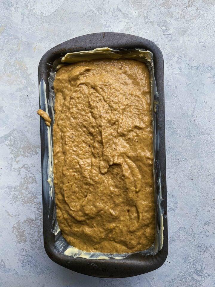 Pumpkin bread batter in a loaf tin
