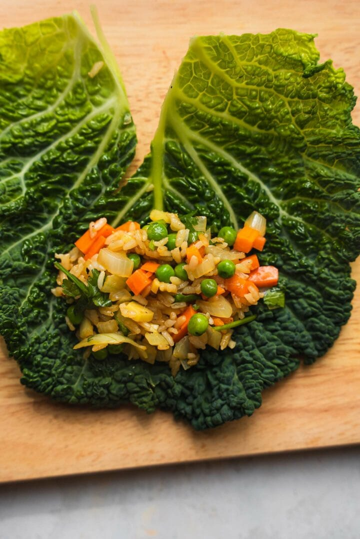 Rice and vegetables on a cabbage leaf