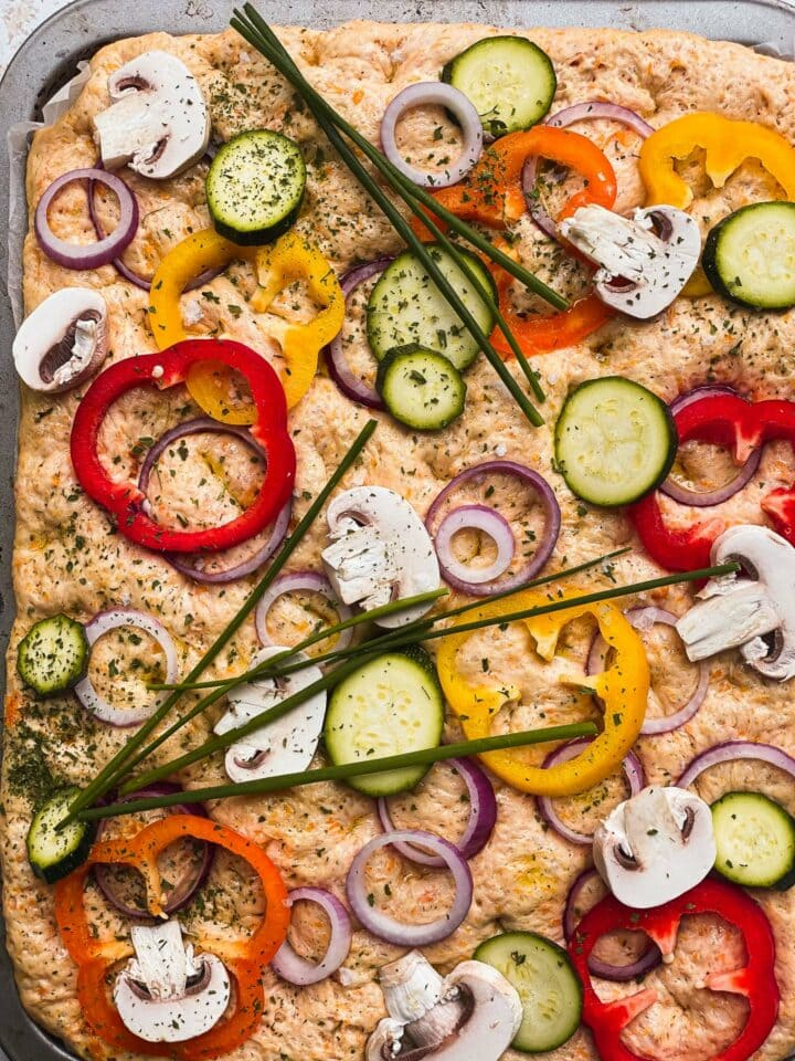 Vegan focaccia dough with vegetables