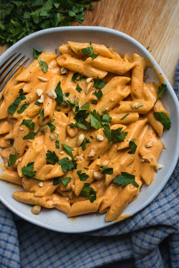 Vegan pasta with a cheesy vegetable sauce