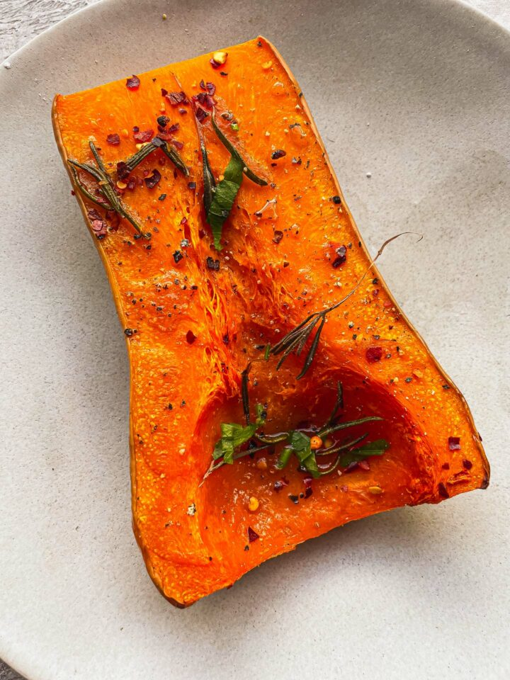 Baked butternut squash half on a plate