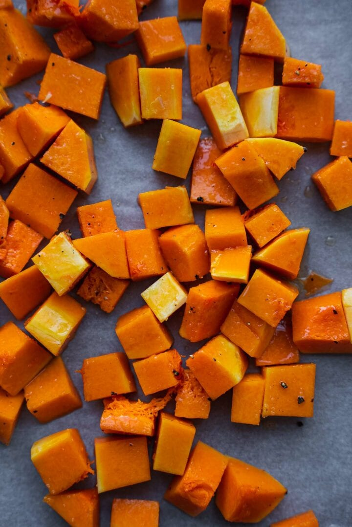 Butternut squash cubes on a baking tray