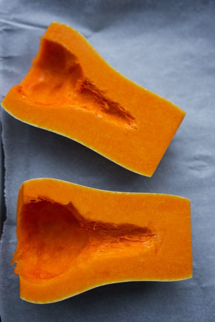 Butternut squash halves on a baking tray