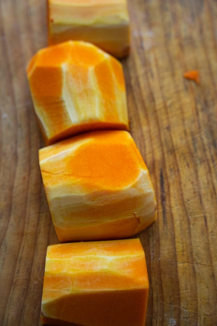 Butternut squash pieces on a board