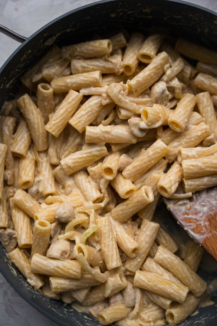 Pasta with hummus sauce in a frying pan